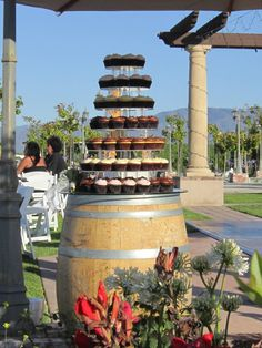 Lori and Ryan's dessert table is a wine barrel as the wedding and reception is at the Temecula CA Winery.