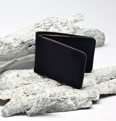 With a slight taper and slim profile, the award winning Billfold is a pared-down wallet with a neat, simple shape. Six card slots, a SIM card slot and cash sleeve hold the essentials.