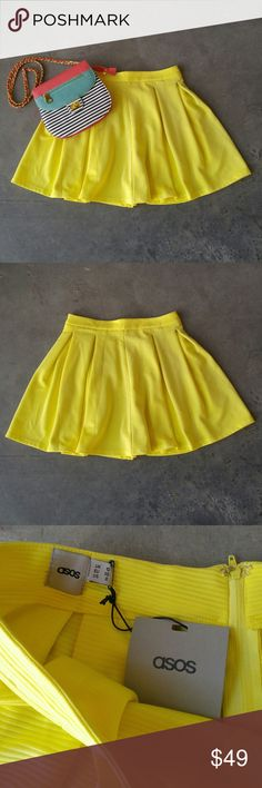 """ASOS Bright Yellow Full A-Line Skater Mini Skirt ASOS skirt, size 6 ( small), in perfect new with tags condition! Vibrant yellow color is perfect for spring! Style is full / a-line / skater. Has pleats. Zipper in back. Thick fabric, not lined. 14.5"""" waist, 17"""" length. 97% polyester, 3% elastane. Please ask any questions. No trades. Make a reasonable offer. Thanks! *Cover photo accessories not included* ASOS Skirts A-Line or Full"""