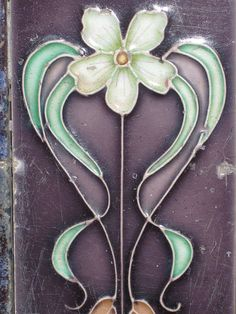 ❤ -  Art Nouveau Tile of a Flower - Thornbury    This beautiful Art Nouveau flower design appears on a tile which features in a shop front along St George's Road in the Melbourne suburb of Thornbury.