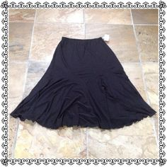 """NWT Panelled Flowy Black Spandex Midi Skirt Brand new never worn. Excellent wardrobe staple, perfect for travel. Comprised of easy care polyester/spandex. Versatile piece to dress up or down. Stretch waist measures 12.5"""" laying flat, waist to hem length approximately 30"""". Selling for a friend so best price up front and firm. No trades or PP. Thanks for looking :) Jessica  Skirts Midi"""