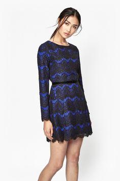 "<ul> <li> Cotton-blend lace shift dress</li> <li> Scalloped and raw lace trims and hem</li> <li> Round neck</li> <li> Long sleeves</li> <li> Detachable velvet waist belt with back popper fastening and front bow detail</li> <li> Zip placket at back with hook and eye clasp fastening</li> <li> Lace overlay throughout</li> <li> UK size 10 length is 86.7cm</li> </ul>  <strong>Our model is 5ft 9.5"" and is wearing a UK size 10.</strong>"