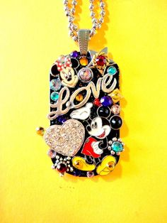 One Of A Kind BRADOS Bling Mickey Mouse And Minnie Mouse Dog Tag Pendant. All pendants are made with Swarovski crystal rhinestones, modern and vintage