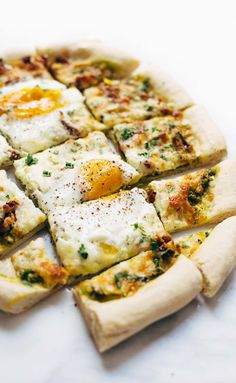 Breakfast Pizza by pinchofyum: Kale pesto, sun dried tomatoes, sausage, cheese, herbs, and eggs baked right on top. Super easy and adaptable recipe for brunch. Can be made vegetarian. #Pizza #Breakfast #Kale #Egg | pinchofyum.com