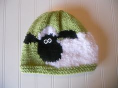 baby picture would be SO cute in the nursery with a sheep hat. =) haha
