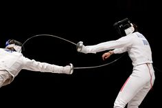 Hamlet and Laertes battled in a fencing dual where Laertes was planned to get just one point on Hamlet and poison him from the tip of the sword.