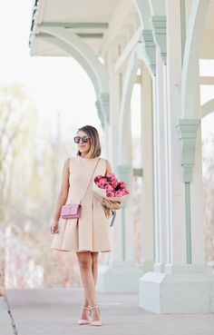 Neutral Outfits & Ideas: Stephanie Sterjovski is wearing a nude pleated Chicwish dress with 424 Fifth heels