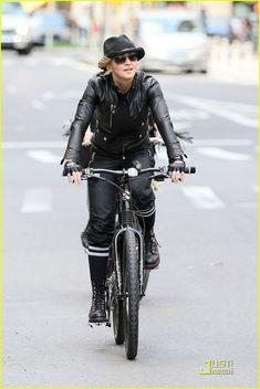 Madonna rides a bike.