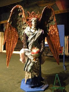 3-D Mixed Media Sculptured Angel. Approximate size: 102″L x 72″w x 36″D. Wire,  copper, stained glass, mirror, silver leaf, tulle, wire screen scrubs, metallic paints.  Sculptural form welded by David Jensen of Lakeview, MI.  rebar, steel, wire fencing, plaster.