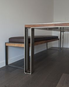 Charles Table + Bench The Charles Table and Bench are made using locally sourced white oak and powder coated steel. The table top is traditionally joined and finished with natural oil. Our signature Post legs are mounted flush with countersunk stainless steel machine fasteners. The Charles