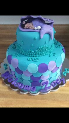 Mermaid baby shower cake with fondant baby