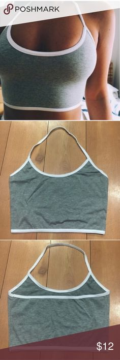 Grey halter crop top Size Small. NWOT never had the guts to walk around in a crop top. Tops