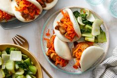 Hoisin Chicken Steam Buns with Sesame Carrots & Ginger Bok Choy. Visit https://www.blueapron.com/ to receive the ingredients.