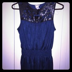 Gorgeous shimmer blue tank with black detail! Love this top!!! Brand is NOTICE! 100% polyester and lightweight. Great top with a pair of black slacks! Can totally dress up or down. Faux black leather detail for neckline is super hot. Cinch near waist makes this a super flattering top. Worn less than a handful of times and in great condition! Notice Tops Tank Tops