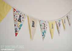 I think this might be Olivias first sewing project.   The Painted Hive | DIY Fabric Bunting Flags Tutorial
