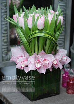 Clean and modern arrangement with #pink orchids and tulips. Pink Orchid, Centerpiec, Floral Design, Orchid Arrangements, Modern Floral Vase, Tulips, Tulip Arrangement, Flower
