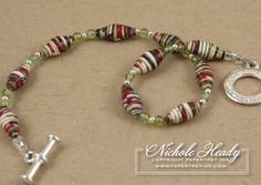 paper bead bracelet.  Video tutorial at papertrey ink here http://nicholeheady.typepad.com/capture_the_moment/
