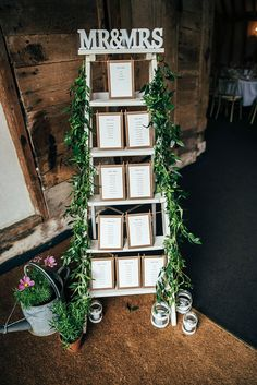 Ladder Seating Plan Table Chart Greenery Foliage Colourful Hand Made Rustic Barn Flower Filled Wedding http://www.threeflowersphotography.co.uk/
