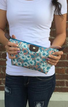 Lovely floral print zippered bag. Use for make-up, travel supplies, hair stuff, or even your jewelry.