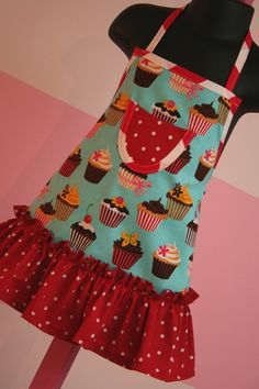 Your little girl will love to help out in the kitchen when she is dressed in this adorable apron. It features a pretty ruffled skirt and small
