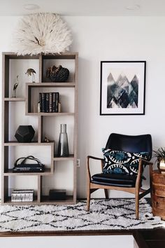 Gorgeous shelf styling vignette with juju hat. I love the neutrals and Mid Century Modern inspired design.