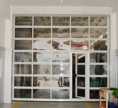 Glass Garage doors instead of french doors to open up to deck or patio???  I like it!
