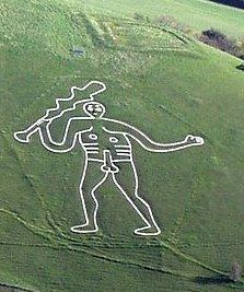 The Cerne Abbas Giant is a hill figure near the village of Cerne Abbas in Dorset, England. Made by a turf-cut outline filled with chalk, it depicts a large, naked man, with a substantial erect penis, typically described as a giant, wielding a club. The figure is listed as a scheduled monument in the United Kingdom and the site where he stands is owned by the National Trust.  Wikipedia