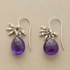 "PEACE OF MIND EARRINGS -- A pair of dangling amethyst drop earrings, with a frivolous cluster of faceted sterling beads grounded by amethyst, symbolizes serenity and peace of mind. Handcrafted exclusively for Sundance with sterling French wires. 7/8""L."