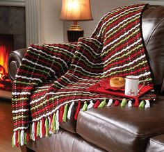 Cuddle up under this woven plaid blanket. Designed by Sheila Whitson.