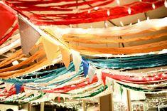 gorgeous multicolored fabric draping! // photo by FatOrangeCatStudio.com