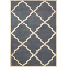 A unique abstract design highlights this hand-tufted World Classic wool rug. This hand-washed area rug features shades of bluish-grey with a cream border.