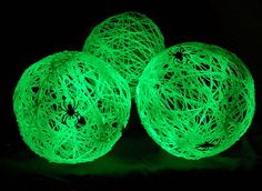 These glow in the dark spider balls were made with balloons, yarn, glow in the dark spray paint, glue, and petroleum jelly. Throw some spiders on for extra spooktacularity. #Halloween #Crafts and #Ideas