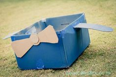 What a great idea! Turn a cardboard box into an airplane for races, games, photo booth, etc.