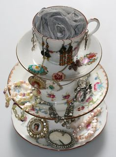 Mismatched cups and saucers, glued together, become a place to hold and display jewelry. How creative!