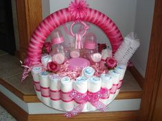 Diaper Basket   If building a cake isnt your thing, take some inspiration from this diaper basket ($45). The actual basket is made from rolled-up diapers and filled with bottles, brushes, and more.