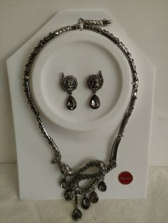 Murano Jewelry Set Necklace With Earrings Murano Cristalleria Jewelry Stunning formal wear/ballroom sparkles, MSRP is $249 Necklace is about 18 with about a 1 extension and is in the shape of a snake with matching snake Post Dangle Earrings which are about 1 1/2 from top to bottom Beautiful Gray or Gunmetal color Glass stones that sparkle Box will be over-sized for the necklace & earring set card, we want to make sure it makes it to you in perfect condition  Please see pictures...
