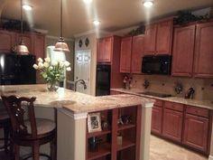 Kitchen with black appliances.