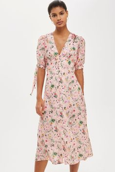 From ditsy floral midis to statement pink suits, Topshop's drop of feminine heroes means there's plenty to get excited about. A new collaboration with Liberty sees dresses, skirts and tops adorned with classic archival prints; we love the bubblegum ruffled minis and understated frilled skater dresses. The tie-back cami with bow detailing is another stand out, whilst smart tailoring and striped shirting is catering for fans of androgynous style.