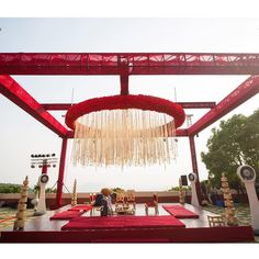 A canopy of white and red blooms with an amazing background view is the perfect spot to exchange vows😍