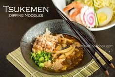 Tsukemen is cold ramen noodles topped with nori, shrimp, egg. Dip the ramen in warm pork belly and mushrooms soup flavored with Doubanjiang.
