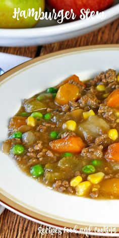 Hamburger Stew This hearty and delicious beef stew is made with ground beef, carrots, potatoes, celery, onions, corn and peas.: