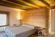 Dormitorio casa de madera Kuusamo Log Houses en Begues #Barcelona
