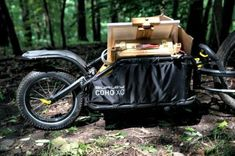 The Coho XC single wheel cargo trailer brings durability and thoughtful design to gear-hauling for bike camping, touring and singletrack riding. Bike Cargo Trailer, Cargo Trailers, Touring, Make It Simple, Baby Strollers, Easy, Tech, Google, Image
