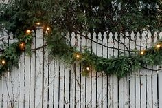 and old white fence and christmas garland with lights gorgeous