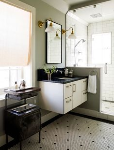 Hexagonal floor tiles befitting a Federal-style home are juxtaposed with a modern floating vanity. Traditional Bathroom, Traditional House, Modern Traditional, Interior Design Kitchen, Interior Decorating, Decorating Ideas, Federal Style House, Lauren Liess, Bathroom Styling