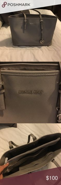 Michael Kors large tote - light gray Light gray MK tote with silver accents. Two internal zip pockets, 2 accessory pockets. Extra condition. Slight fraying on one shoulder strap. Dimensions: 16 inches wide, 11 inches high, 5 inches wide. Bags Totes