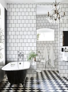 Black and white bathroom in a stunning industrial-style home in Lund, Sweden…