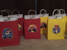 DIY Blaze and The Monster Machines birthday decor - party favor bags filled with crayons, free Blaze coloring sheets, and more! Cut out photos of Blaze and glue to paper bags!