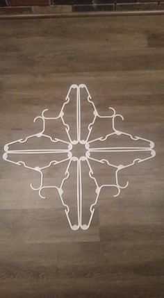 Coat Hanger Snowflake - - This Christmas craft tutorial with pictures gives you instructions on how to make a snowflake wall art using plastic coat or clothes hangers. The hangers that we used were all store bought and can …. Diy Christmas Snowflakes, How To Make Snowflakes, Outside Christmas Decorations, Snowflake Craft, Snowflake Decorations, Christmas Crafts, Kids Christmas, Christmas Wreaths, Dollar Tree Crafts