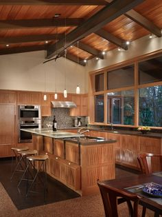 I don't care for the chairs, but I love the fusion of wood and modern kitchen